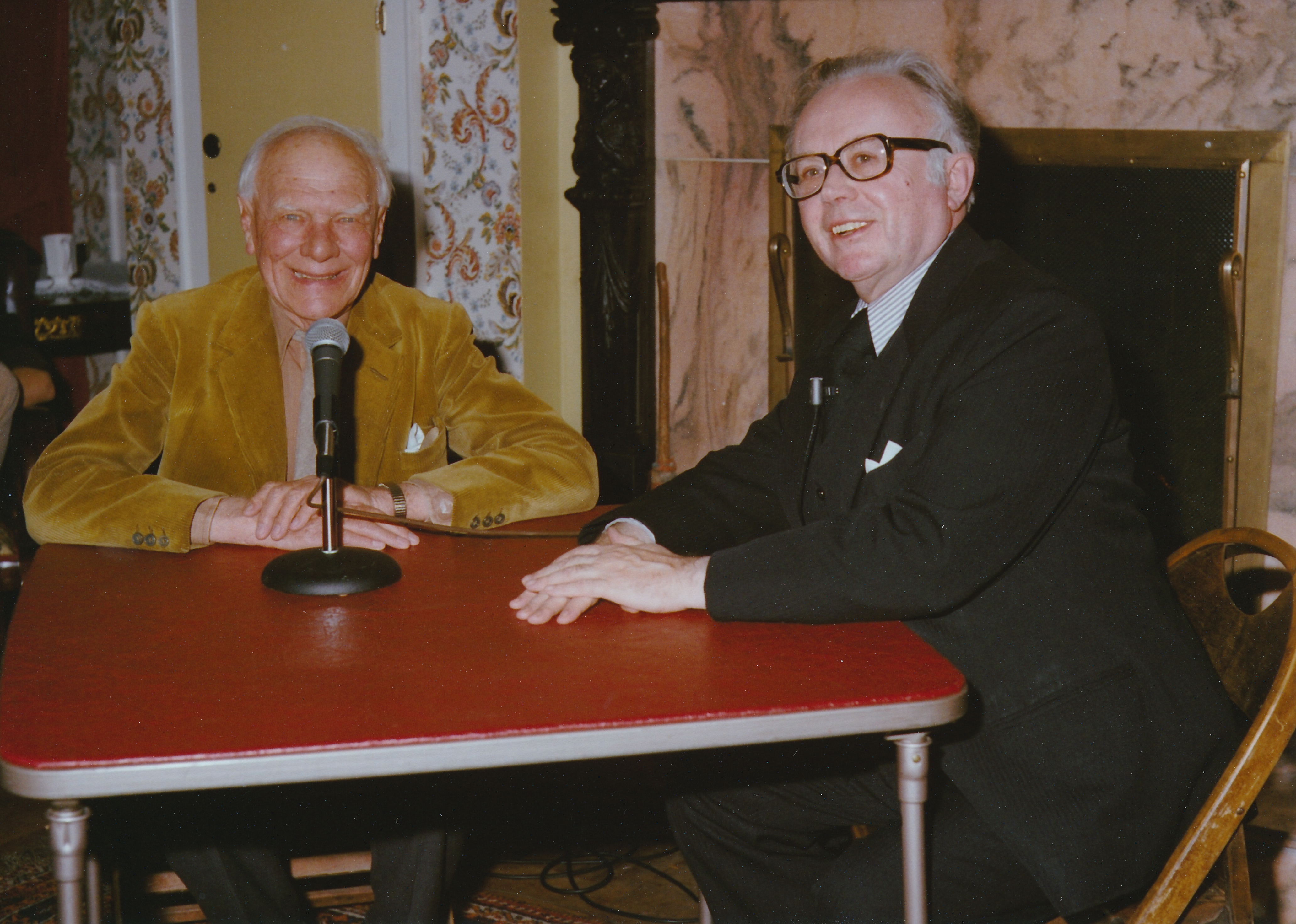 English journalist Malcolm Muggeridge and Kirk answering questions at the Kirk home.